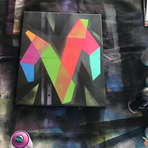 Spray paint painting of the letter M